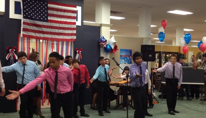 West Side School patriotic celebration, students singing