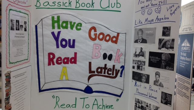 "A board reading ""Have you read a good book lately?"" at the Bassick High School Book Fair"