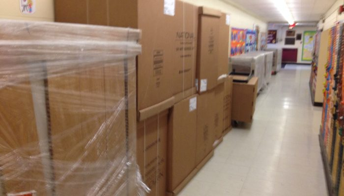Boxes of equipment - The Insalco team gets the O'Brien Family Resource Center set up