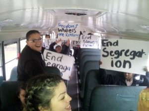 "Bassick High School students are ""on the bus"" to go listen to the Freedom Riders with CommPACT Specialist Sal Hanaif,"