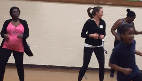 O'Brien Teacher Leader Molly Waszkelewicz joins students and parents in hip hop dance moves