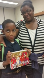 CommPACT supports innovative Bassick High School Parent/Student/Family Book Club The Bassick Book Club encourages parent Dione to read with her son, Tione