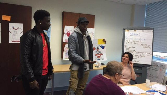 Demetri Smith (Bassick graduate) and Mid Nite (Bullard Havens graduate) help the Youth Summit team select winner of t-shirt contest.